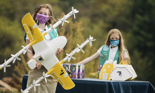 Girl Scouts with a Wing delivery drone.